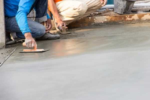 worker smoothing out cement