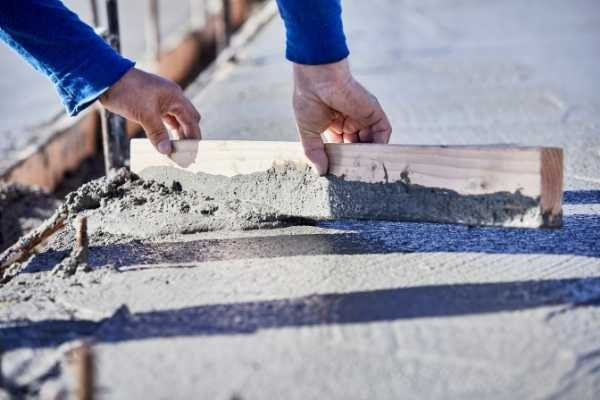 workers smoothing out cement