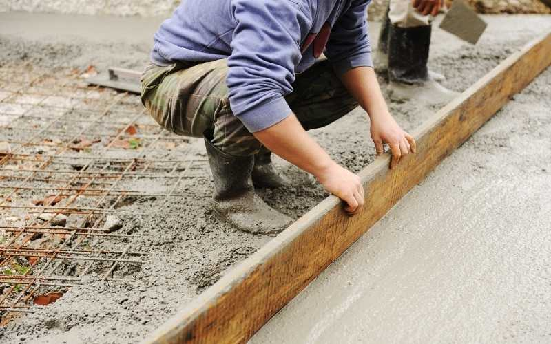 concrete miami workers leveling cement